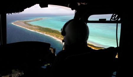 A National Guard plane searches the area near the coral reef where an aircraft disappeared near the Los Roques archipelago